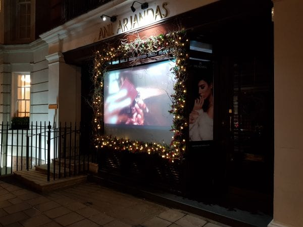 Anil Arjandas enjoy the projection, privacy and security advantages of using a Switchable Projection Screen in their window display