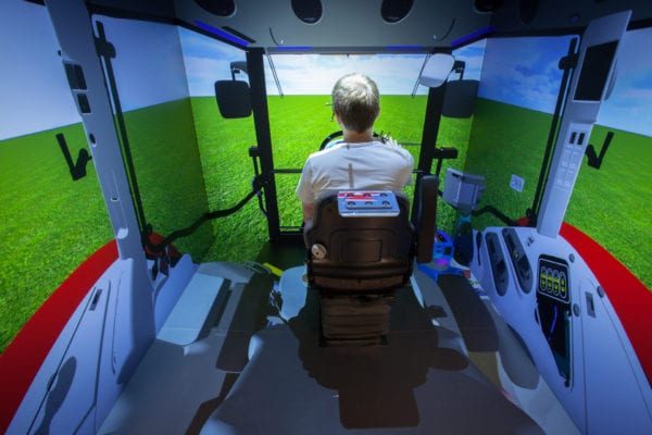 CAVE Projection System Simulating the inside of a tractor for training
