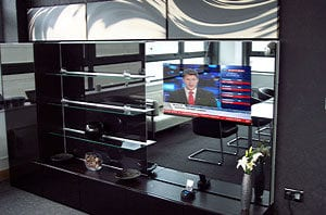 Mirrorvision TV overlay integrated into furniture