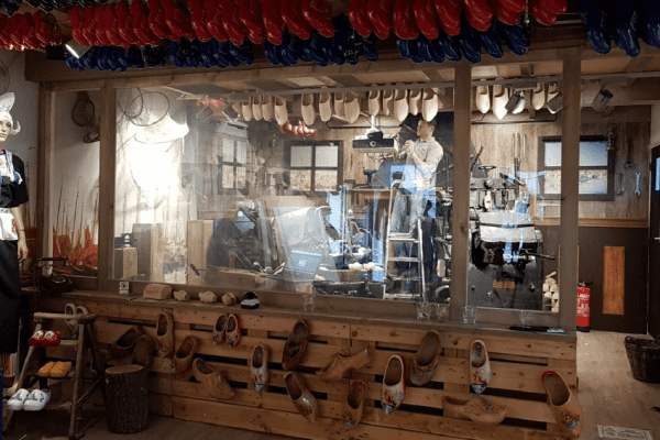 Switchable partition switched on, revealing the authentic Dutch Clog making workshop behind
